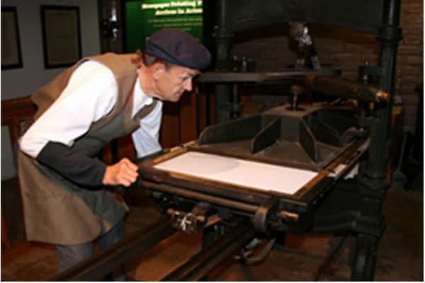 James Pagels demonstrates the Tubac Presidio Washington Hand Press