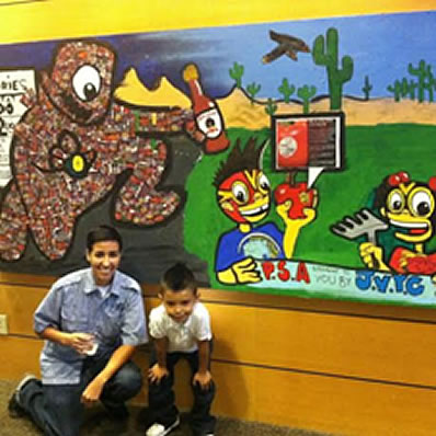 Dominguez and student artist with anti-Junk Food mural